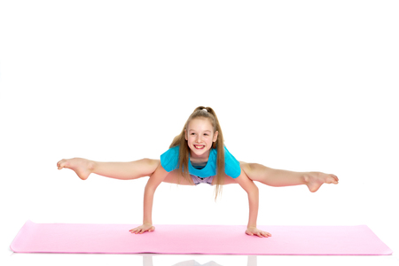 girl gymnast performs a handstand.