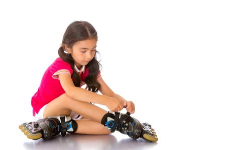 Asian girl wears roller skates. Stock Photo
