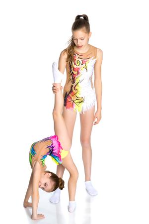 Girls gymnasts warm up. Stockfoto