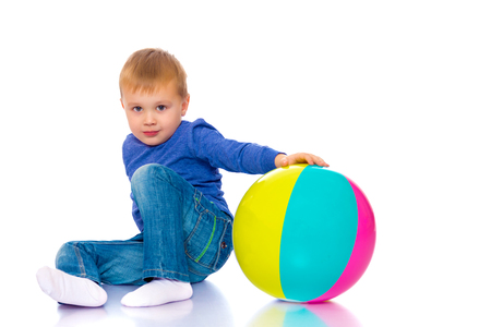 A little boy is playing with a ball. Archivio Fotografico