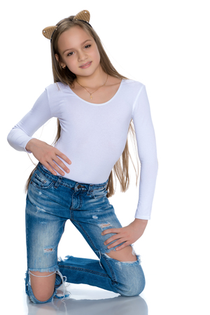 Beautiful teen girl in jeans with holes. 版權商用圖片