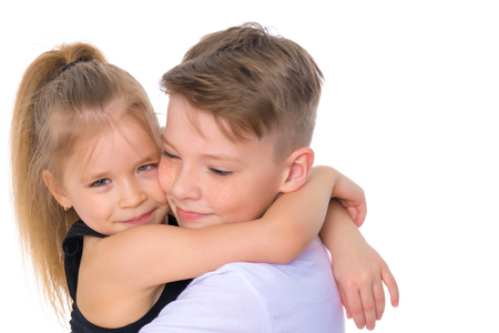 Brother and sister embrace. Stockfoto