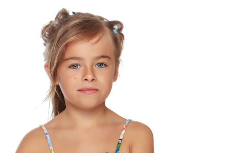 Tanned little girl in a swimsuit Standard-Bild