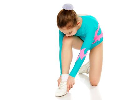 Young girl acrobat perform exercises. Standard-Bild