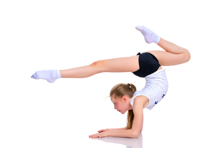 A gymnast performs an exercise stance on her forearms. Imagens - 101306321