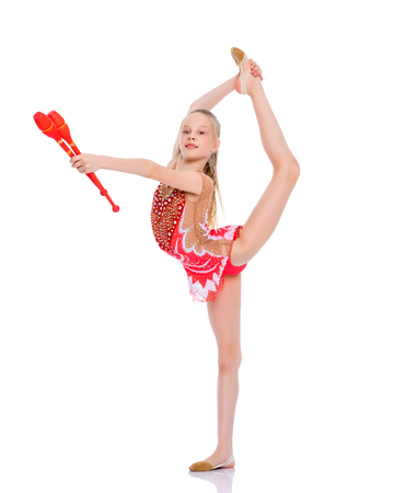 A girl gymnast performs exercises with a mace. Standard-Bild - 101627572