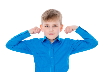 A little boy shows his strength Stock Photo