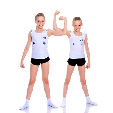Girls gymnasts show their muscles.