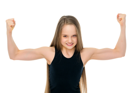 A little girl shows her muscles. 写真素材