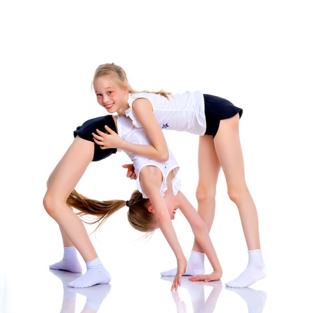 Girls gymnasts perform exercises.