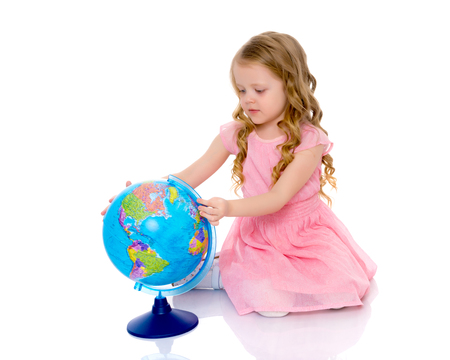 A little girl looks at the Globe.
