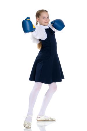 Girl schoolgirl in boxing gloves.
