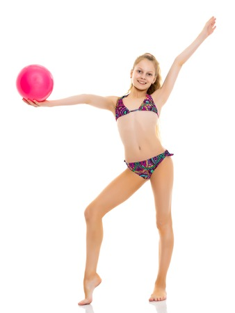 Little girl in a swimsuit with a ball Stockfoto