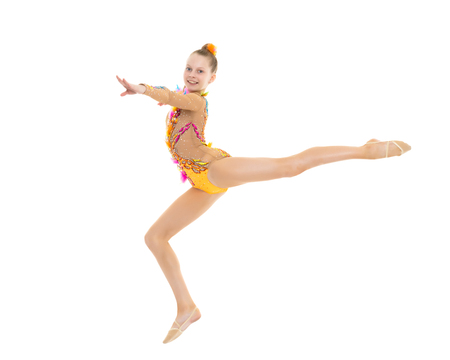 The girl gymnast performs a jump. 写真素材