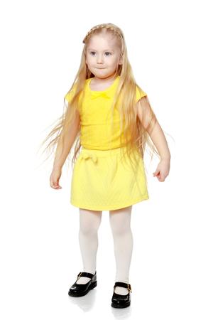 A little blonde in a yellow t-shirt.