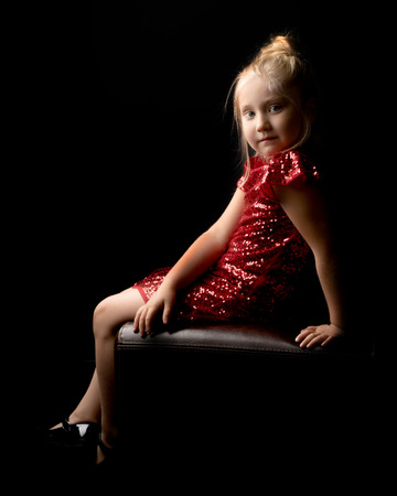 Little girl on a black background