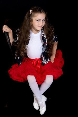 Little girl on a black background