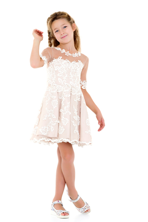 Little girl in an elegant dress. Stock Photo
