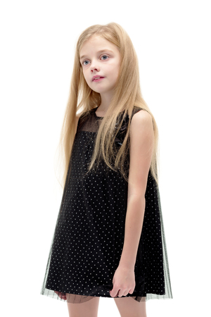 Little girl posing in the studio. Close-up.