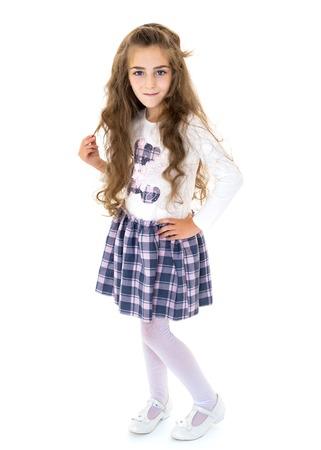 Beautiful school girl with long silky hair.