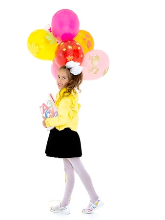 Girl schoolgirl with books and balloons.