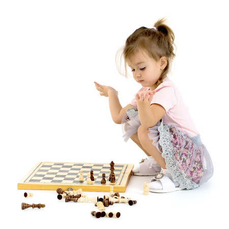 Little girl playing chess 스톡 콘텐츠