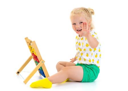The girl counts on abacus Reklamní fotografie