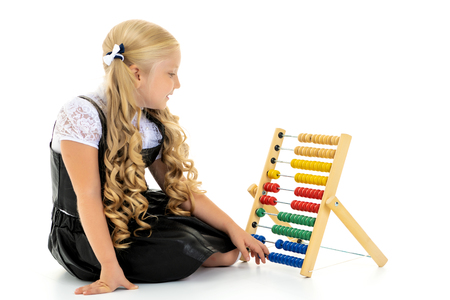 The girl counts on abacus Reklamní fotografie