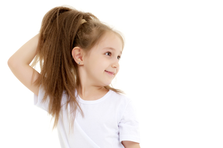 Emotional little girl in a clean white T-shirt.