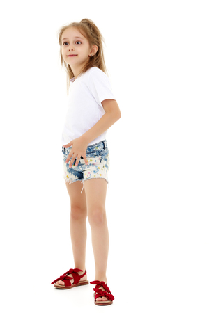 Little girl in a pure white t-shirt for advertising and shorts.