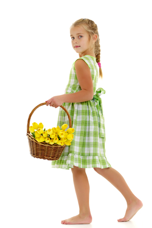 Cute little girl with a basket of flowers. 写真素材