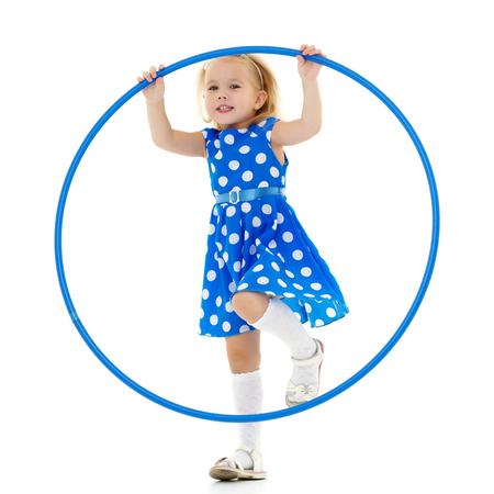 The little girl turns the hoop.
