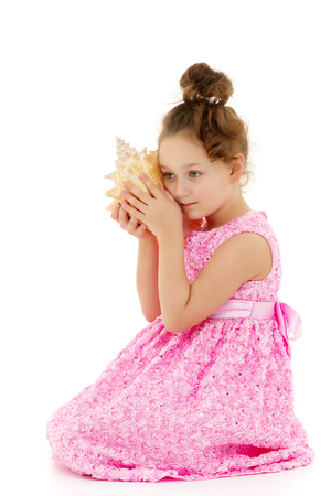 Little girl with sea shell 写真素材