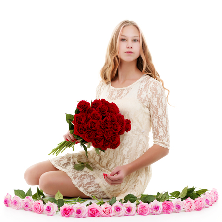 A teenage girl with a bouquet of flowers.