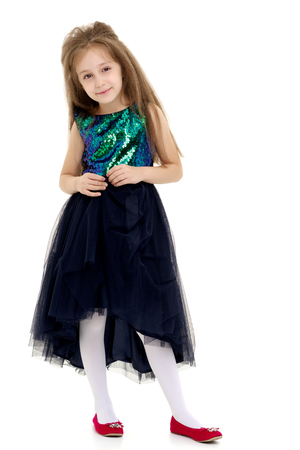 Elegant girl in a dress.