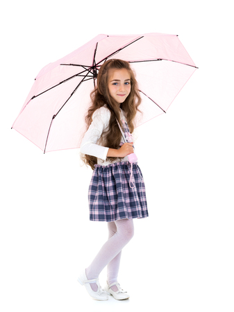 Little girl under an umbrella.