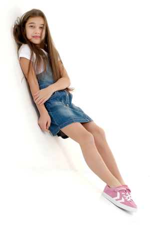 Little girl in a short denim dress.