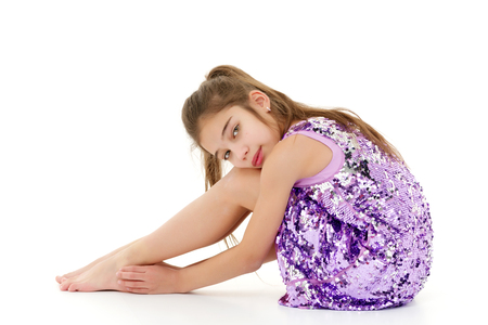Little girl hugging her knees. Stockfoto