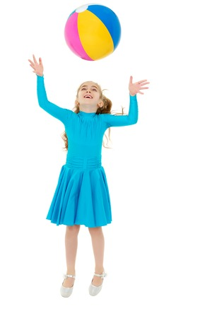 The little girl is catching the ball. 免版税图像