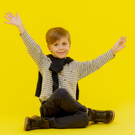 The little boy is emotionally waving his arms.