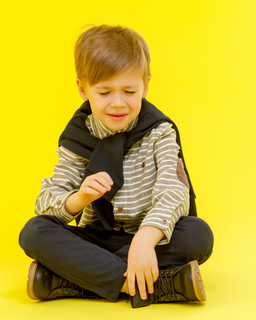The little boy cries with tears.