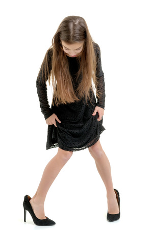 Little girl in large size shoes.