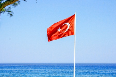 Turkish flag on the background of the sea.