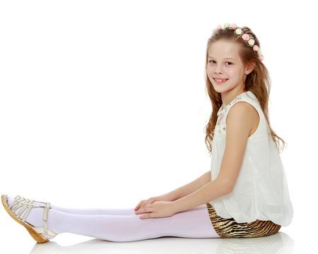 Little girl hugging her knees. Standard-Bild