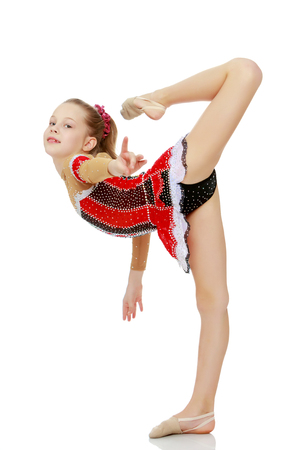 The gymnast balances on one leg.