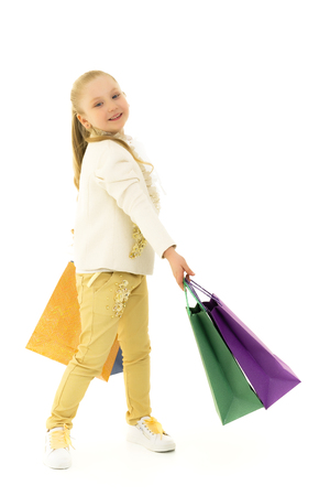 Little girl with multi-colored bags in their hands. Stok Fotoğraf