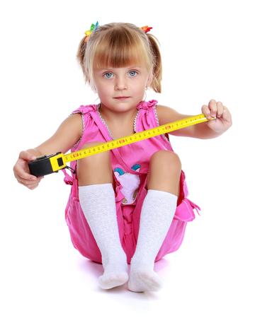 Little girl with a building tape measure.