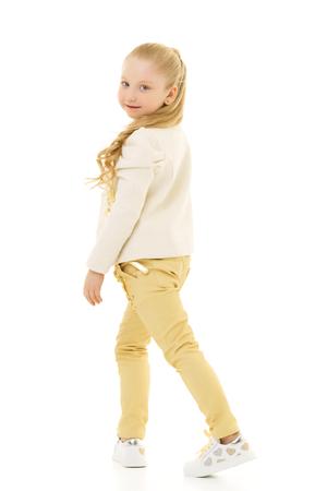 Beautiful school girl with long silky hair. Stock Photo - 124756265