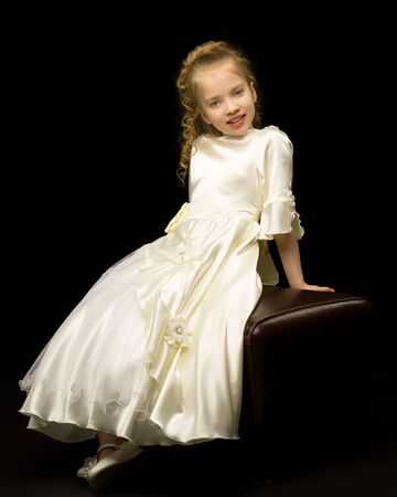 Little girl on a black background Stock Photo - 124757012