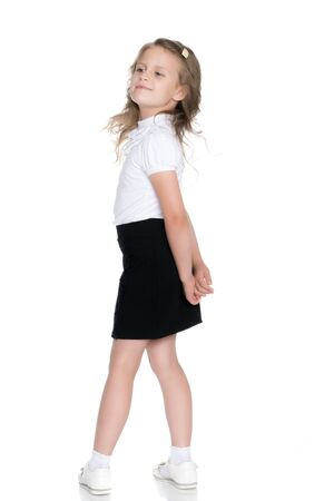 Fashionable little girl in a dress Stock Photo - 124757024